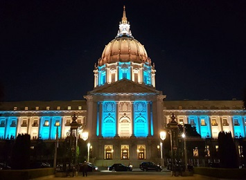 state-builindg-lit-blue-for-pf-awareness-month