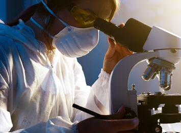 researcher-looking-through-microscope