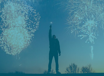 person-with-fireworks-behind-them